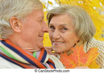 Happy elderly couple at nature