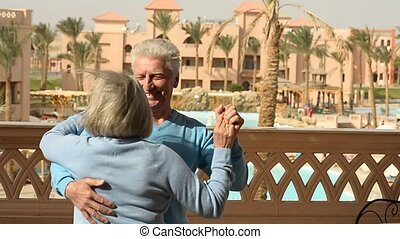 Happy elderly couple dancing