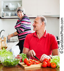 happy elderly couple doing chores