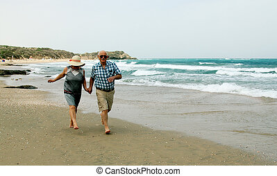 Happy elderly couple enjoying their vacation near the sea