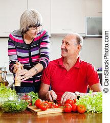 happy elderly couple  in home kitchen