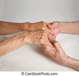 Happy elderly couple. Old people holding hands.