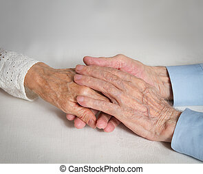 Happy elderly couple. Old people holding hands. - Old people...