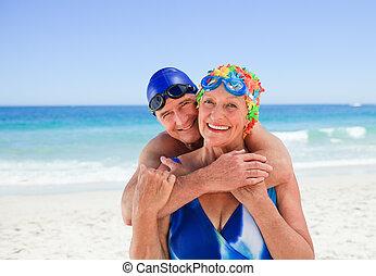Happy elderly couple on the beach