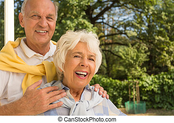 Happy elderly couple - Portrait of happy elderly couple...