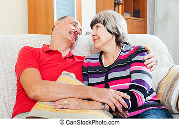 Happy elderly couple relaxing together
