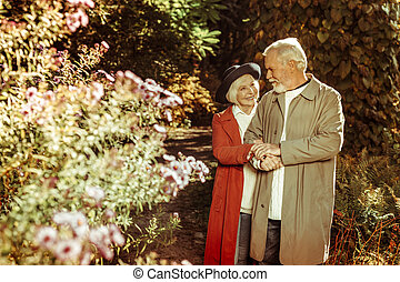 Happy elderly couple taking a stroll together.