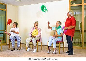 Happy elderly ladies in a gym
