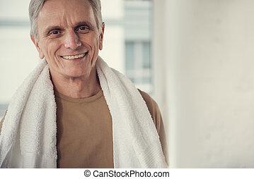 Happy elderly male enjoying his pastime