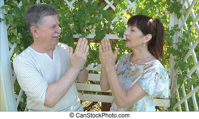 Happy elderly man and woman