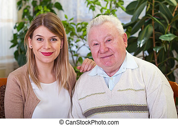 Happy elderly man with granddaughter