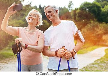 Happy elderly people taking a selfie