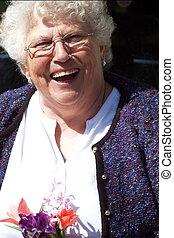 happy elderly woman - a happy senior woman