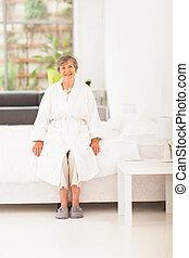 happy elderly woman in pajamas