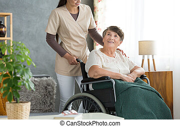 Happy elderly woman in wheelchair