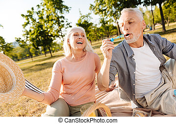 Happy elderly woman looking at her man