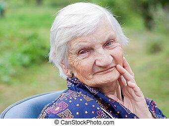 Happy elderly woman - Handicapped elderly woman sitting in a...
