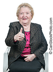 Happy elderly woman showing thumbs up