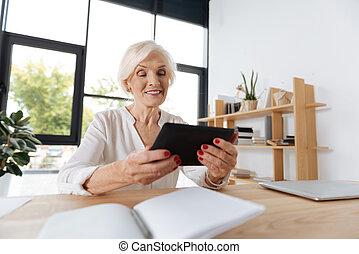 Happy elderly woman smiling