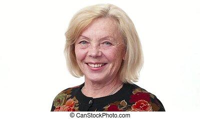 Happy elderly woman smiling, white background
