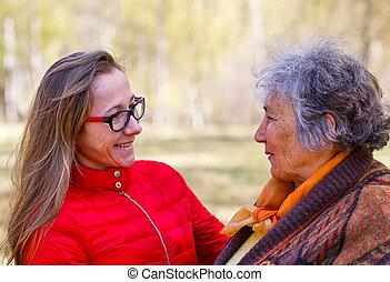 Happy elderly woman with her daughter