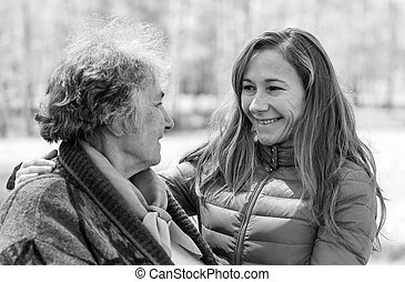 Happy elderly woman with her daughter - Portrait photo of...