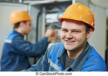 happy electrician engineer worker - Happy young adult ...