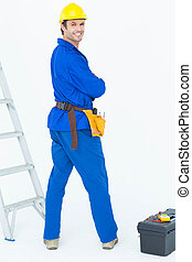 Happy electrician looking over shoulder - Portrait of happy...
