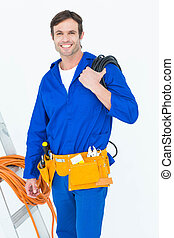 Happy electrician with wires over white background