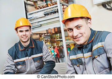 happy electrician workers