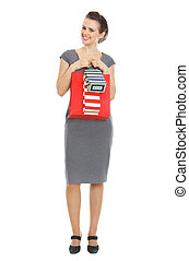 Happy elegant woman with shopping bags