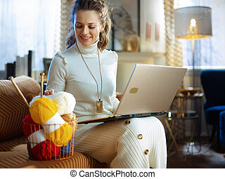 happy elegant woman with yarn learn how to knit