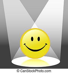 Happy Emoticon Smiley Face in Spotlight - A shiny yellow...