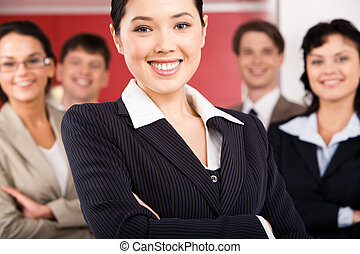 Happy employer - Portrait of cheerful female leader standing...