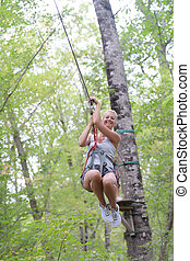 happy enthusiastic woman having great time in the adventure park