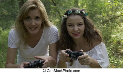 Happy euphoric and desperate women playing console...