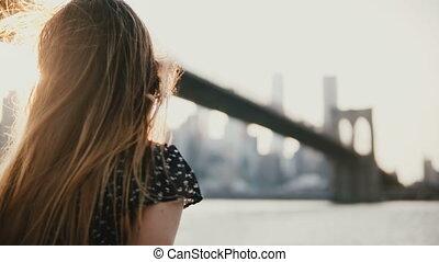 Happy European girl in sunglasses smiling, enjoying amazing...
