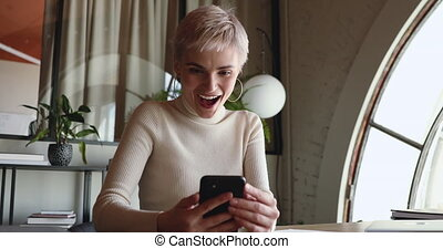 Happy excited businesswoman using smart phone reading good ...