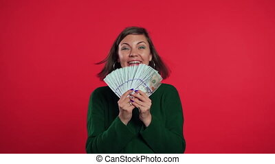 Happy excited girl in green sweater showing money - U.S. ...