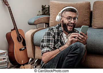 Happy excited man listening to his favourite song