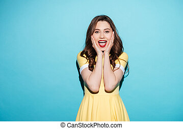 Happy excited woman in dress with open mouth