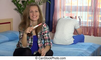 Happy excited woman look at camera and her stressed man with...