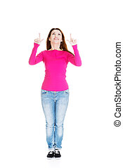 Happy , excited woman pointing on copy space
