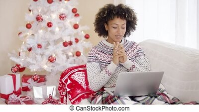 Happy excited woman reading a Christmas message - Happy...