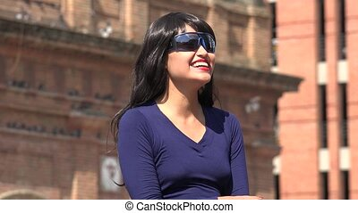 Happy Excited Woman Wearing Sunglasses And Wig