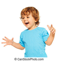Happy exited two years old kid with open mouse and open hands