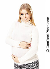 Happy expectation - Beautiful pregnant blonde embraces a...