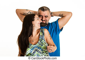 Happy expecting couple sitting - A tattooed man and tattooed...