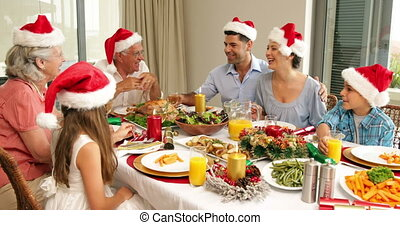 Happy extended family at the Christmas dinner table