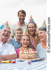 Happy extended family celebrating a birthday